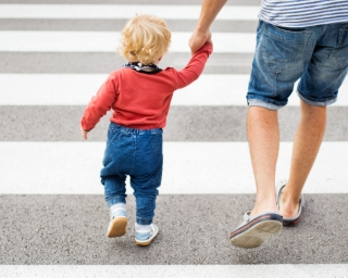 Father and child in crosswalk